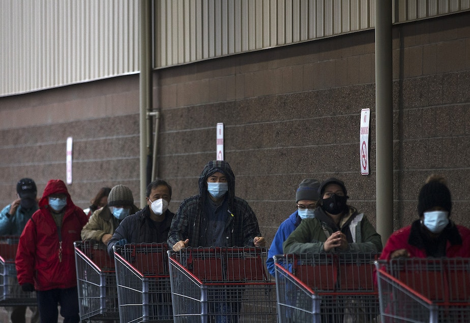 caption: A line forms outside of Costco on Monday, November 16, 2020, on 4th Avenue South in Seattle. New statewide restrictions were announced by Gov. Jay Inslee on Sunday to curb the rapid spread of Covid-19.