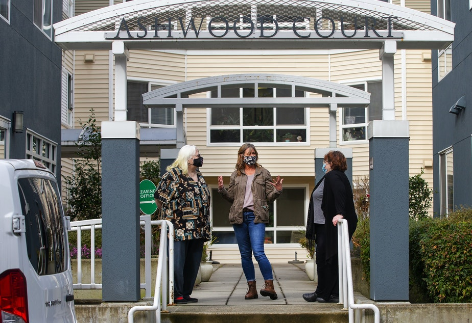 caption: Kim Loveall Price, center, director of a nonprofit that operates Ashwood Court, a low-income housing complex in Bellevue, Wash., talks with residents Susanne Sherman, right, and Joyce Hansbearry.