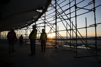The sunset is shown from a suspended scaffolding below the new rotating restaurant in the Space Needle on Monday, November 6, 2017, in Seattle. Tap or click on the first image to see more.