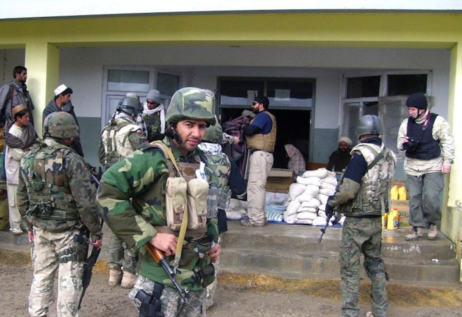 caption: Janis Shinwari wearing his body armor in Afghanistan in 2008. He worked with U.S. troops in some of the most dangerous parts of the country, and the Taliban put him on a 'kill list.'