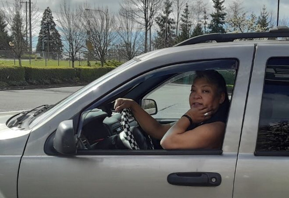 caption: Carey Purnell is a restaurant delivery driver in the Seattle area for Uber Eats. She's also homeless.