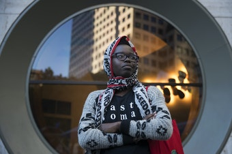 Santa Anigo, 30, poses for a portrait during a rally at Westlake Park on Thursday, June 22, 2017, in Seattle, Washington. Anigo said she wants people to stand up against racism and speak out against prejudice.