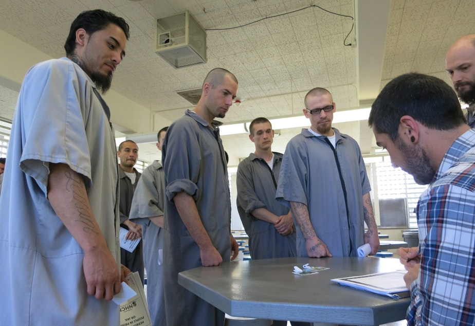 Inmates at the Washington Corrections Center in Shelton receive certificates after a seminar with Rich Feffer of the Hepatitis Education Project.