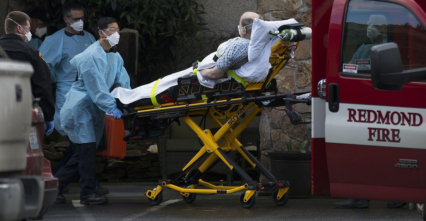 caption: An unidentified patient is transported into an ambulance from the Life Care Center of Kirkland, the long-term care facility at the epicenter of the coronavirus outbreak in Washington state, on Tuesday, March 3, 2020, in Kirkland. It is unclear if the patient is suspected of having coronavirus.