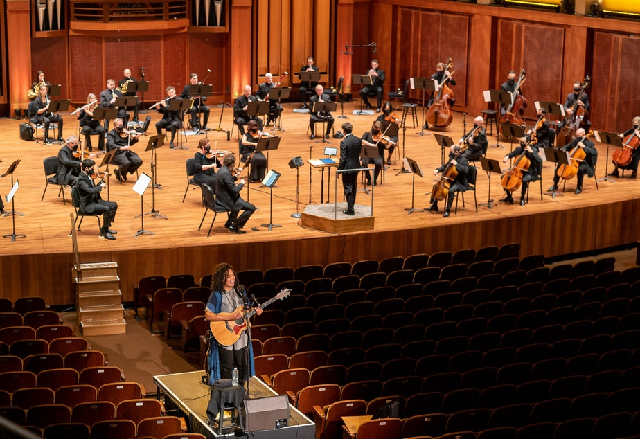 caption: In the first Seattle Symphony performance since the quarantine, musicians were distanced and guest artist Whitney Mongé performed from a separate platform.