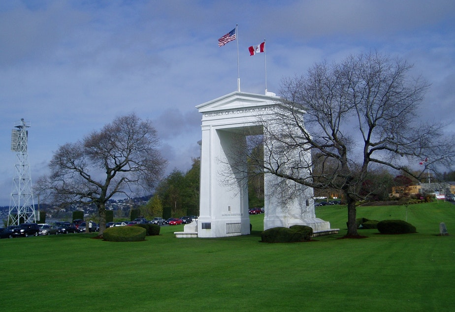 caption: Peace Arch Park reportedly is the scene of lots of weddings this summer featuring Canadian-American couples seeking to ease their border crossing status.