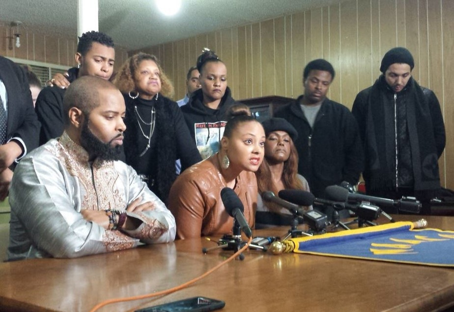 Che Taylor's brother Andre Taylor (left), sister Davitta Briscoe (center) and wife Brenda Taylor appear at an NAACP news conference on Tuesday.