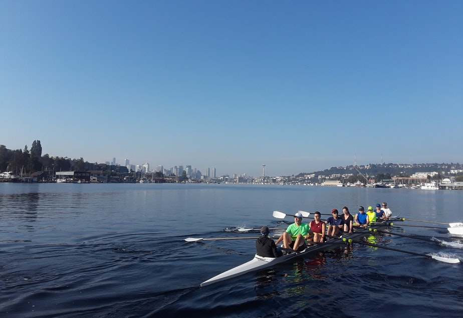 caption: Rowers from the Pocock Rowing Center on the lake one Saturday morning recently.