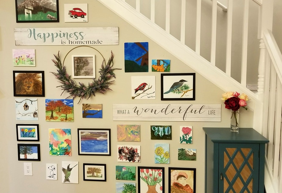 caption: Art by residents hangs in Lilia Magda's adult family home in Vancouver, WA.