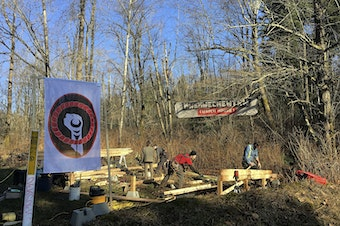 FILE: Anti-pipeline activists build a so-called 'Watch House' near Kinder Morgan's tank farm in Burnaby, British Columbia, Canada, Saturday, March 10, 2018.