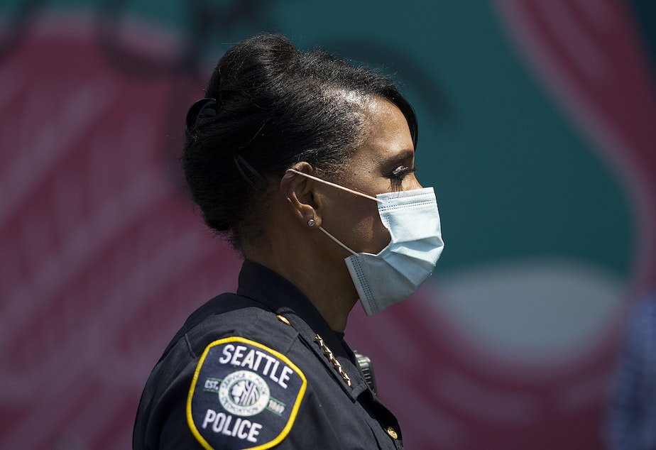 caption: Seattle Police Chief Carmen Best attends a vigil to recognize the senseless killing of African American men and women outside of the First African Methodist Episcopal Church on Monday, June 1, 2020, in Seattle.