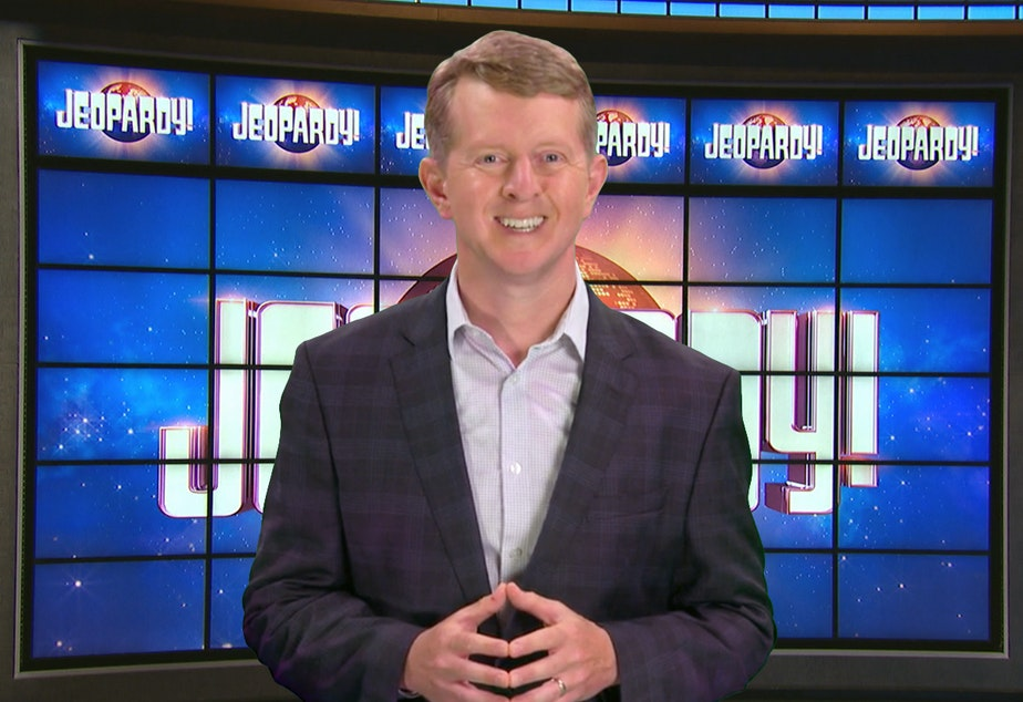 caption: This image released by JEOPARDY! shows Ken Jennings, a 74-time champion the the set of the popular quiz show. Jennings will be the first interim guest for the late Alex Trebek, and the show will try other guest hosts before naming a permanent replacement.