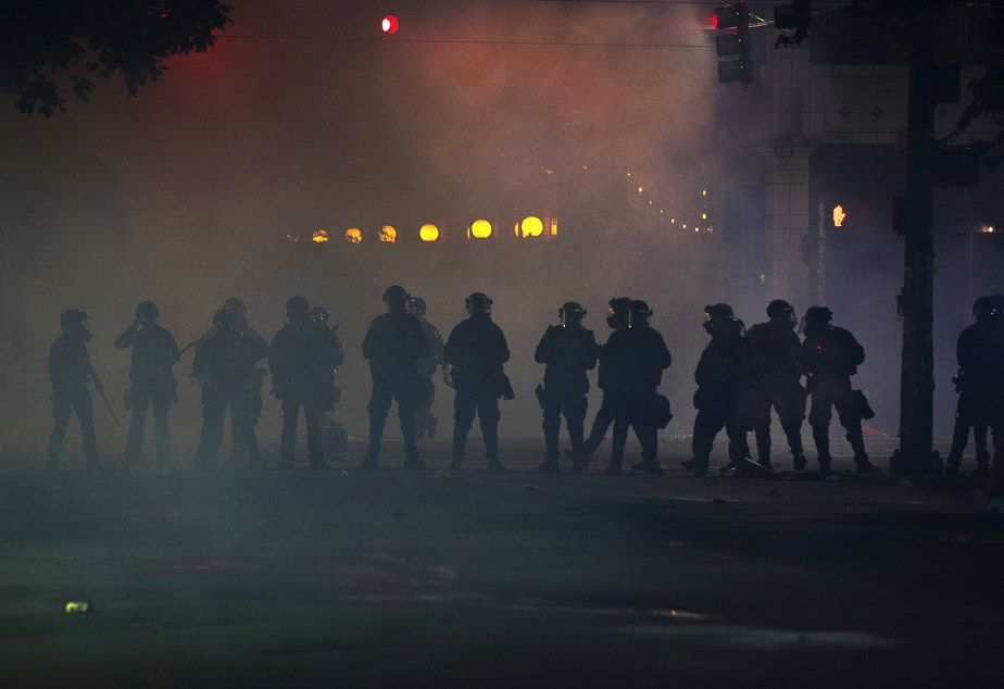 caption: After more than 6 hours of a peaceful protest, law enforcement released tear gas, flash-bang grenades, pepper spray, and rubber bullets on hundreds of people near Cal Anderson Park on Tuesday, June 2, on the fifth day of protests in Seattle following the murder of George Floyd.