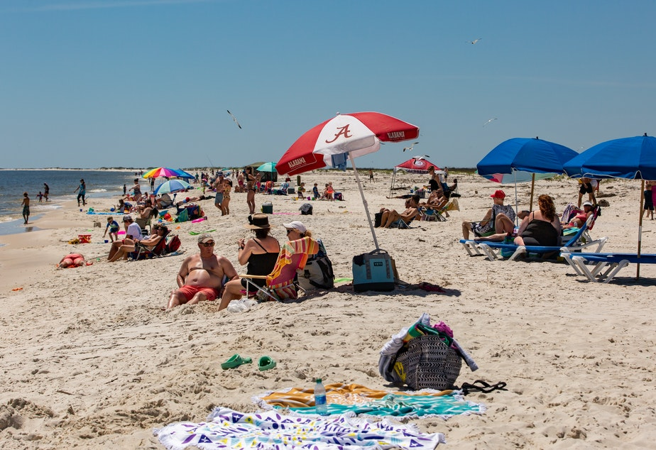 caption: Alabama opened public beaches on May 1. Gov. Kay Ivey is letting casinos, museums, zoos and amusement parks open Friday afternoon.