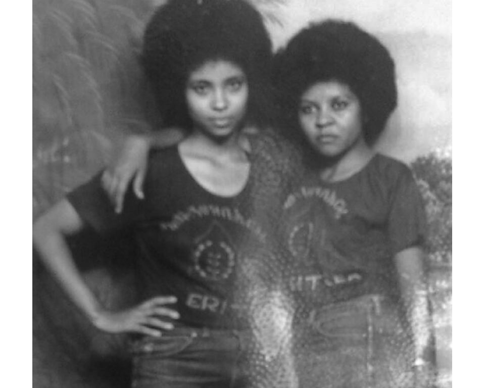 Akberet Asfaha (right) poses with her best friend and fellow soldier, Amna Mohammad. Akberet left home at age 16 without her parents' permission to fight in the Eritrean War of Independence.