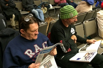 Ken Peterson and Todd Rickdal at the free health clinic hosted at Key Arena Thursday morning.