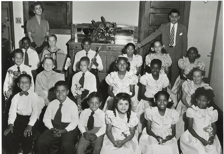 Music teachers Shirley and Louis Wilcox with students at their music school. (To help us ID the children, note the photo number. This is #11.)