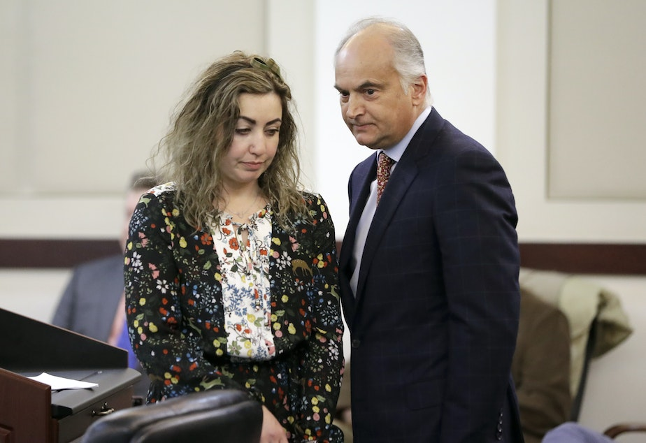 RaDonda Vaught appears at a court hearing with her attorney, Peter Strianse, right, in February, 2019, in Nashville, Tenn. Vaught, a former nurse at Vanderbilt University Medical Center, was charged with reckless homicide after a medication error killed a patient.