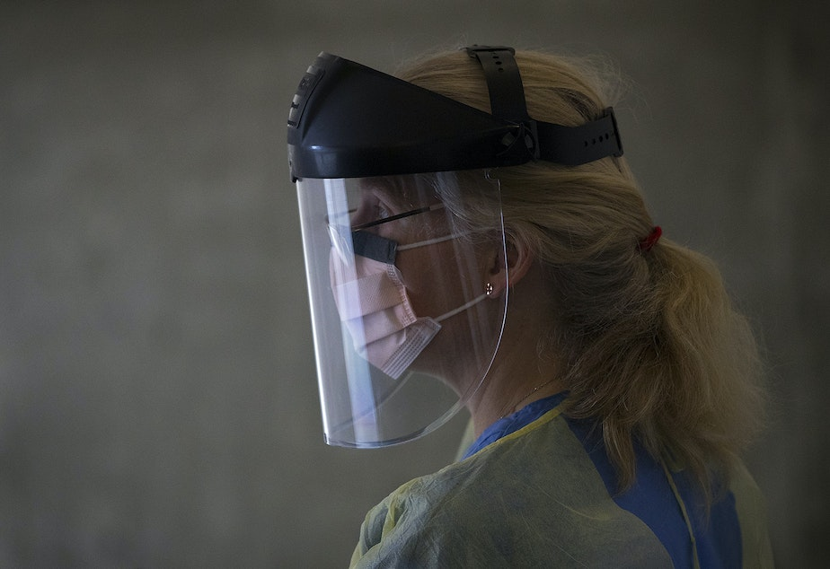 caption: Julie Czartoski, a nurse practitioner at Fred Hutch, waits for first responders to arrive to participate in the Seattle Covid Cohort Study on Wednesday, April 29, 2020, at Fred Hutch in Seattle. First responders with the Seattle Fire Department who either hadn't tested positive for the coronavirus, or had never been tested at all, were tested for the virus as well as for antibodies.