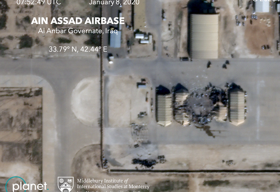 caption: A satellite photo from the commercial company Planet shows damage to at least five structures at the Ain al-Assad air base in Iraq.