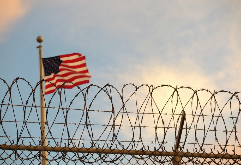 caption: With official charges submitted against three men accused in bombings in Indonesia in 2002 and 2003, the U.S. must arraign the prisoners before a military commission at a U.S. base in Guantanamo Bay, Cuba.
