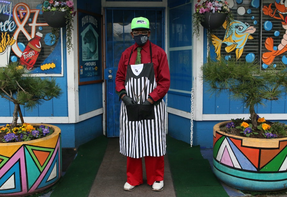 caption: Brother Anthony Mohammad at his Fish House Cafe on MLK Jr Way in Tacoma's Hilltop Neighborhood