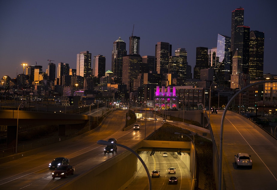 Cars drive into the southern entrance of the SR 99 tunnel as the sun sets on Wednesday, October 9, 2019, in Seattle.