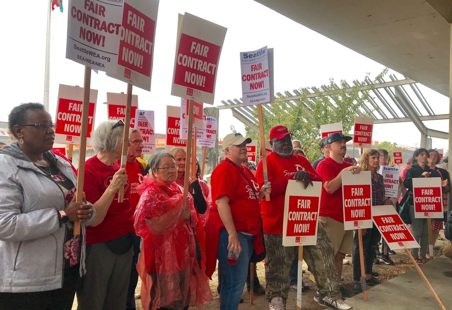 Members of Seattle's teachers union, the Seattle Education Association, rally outside district headquarters on August 21, 2019.
