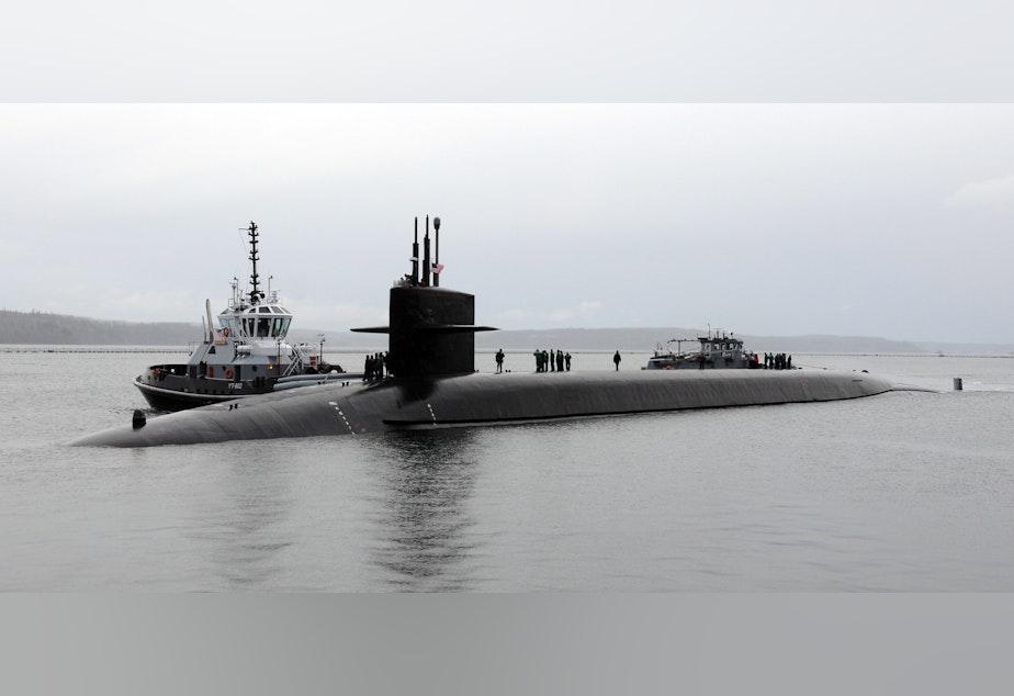 caption: The USS Maine submarine returning to its home port at Naval Base Kitsap-Bangor in January 2012.