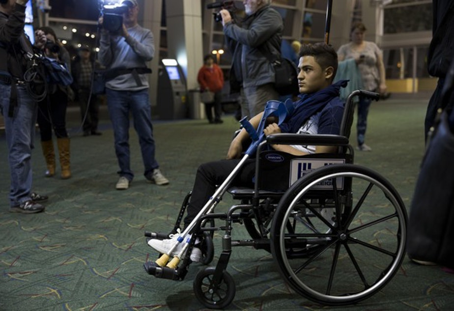 <p>A travel weary Mustafa Abed arrives in Portland for medical attention. His leg was severed near the hip in a U.S. missile strike in Fallujah when he was two.</p>