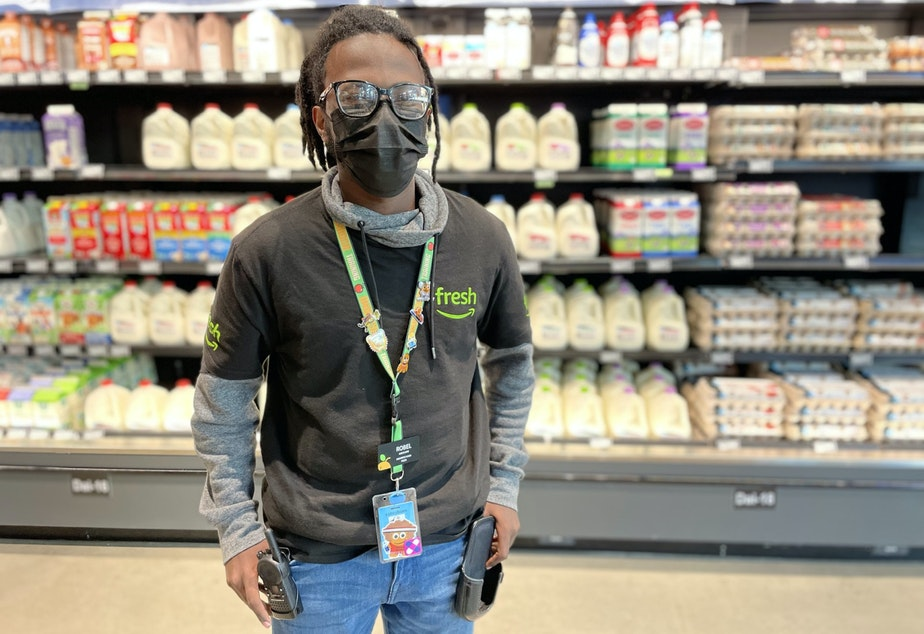 caption: Robel Teshome works at Amazon Fresh in Seattle's Central Area neighborhood. He lives nearby, and walks to work.
