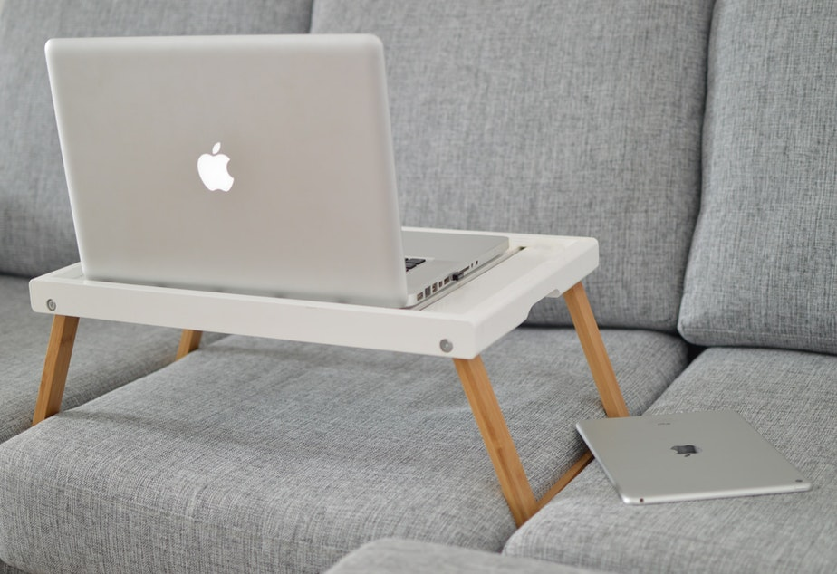 caption: Who says you can't take on the world from a lap desk?