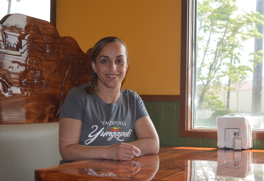 caption: Claudia Reyes manages the popular Mexican restaurant her family owns, theTaqueria Yungapeti in Walla Walla.