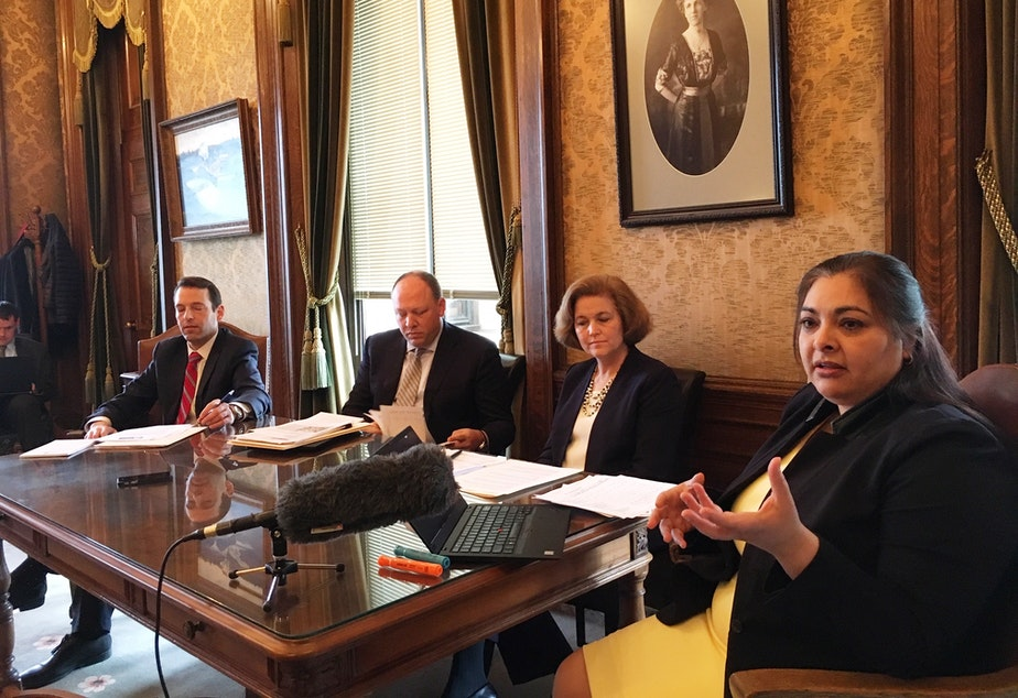 caption: State Sen. Manka Dhingra speaks to reporters during a briefing on the Senate Democratic budget on Friday.