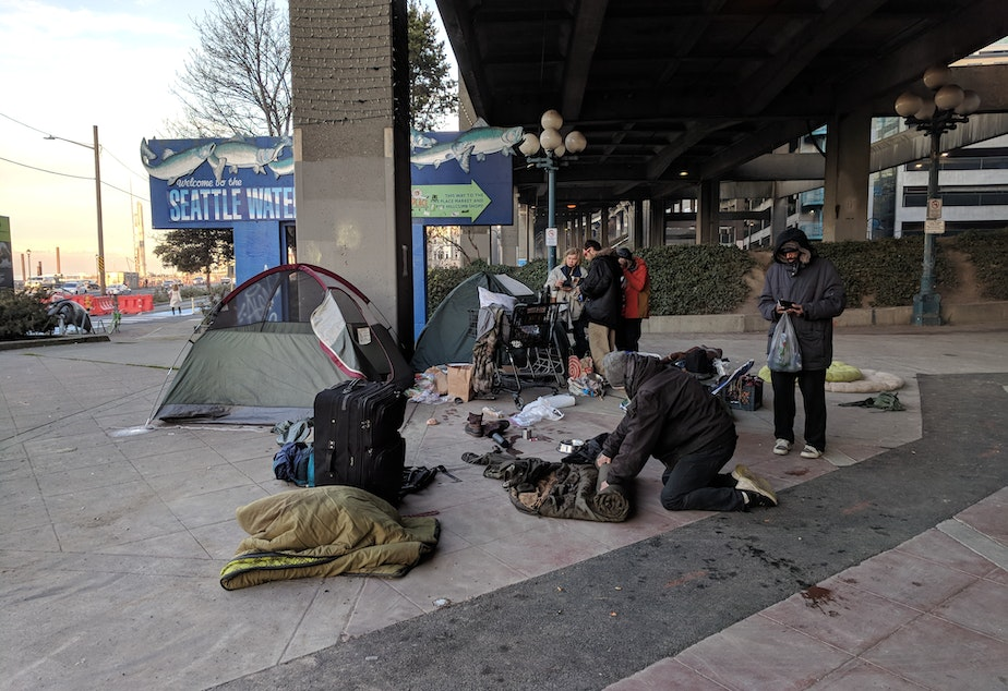 Kenneth Liverman, far right, and his fellow campers prepare to move their tents from under the Alaskan Way Viaduct on Tuesday, January 15 2019.