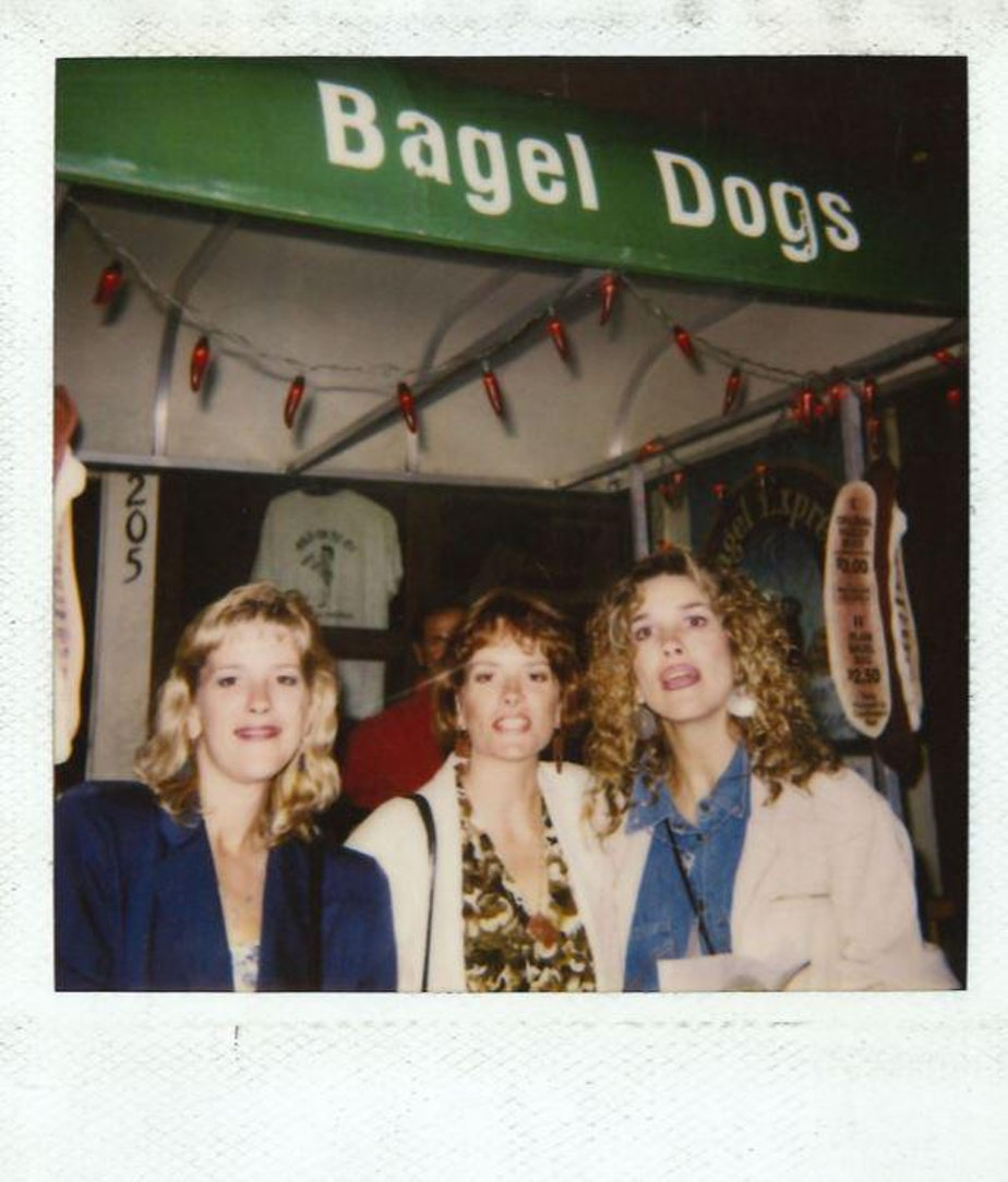 caption: A Polaroid photo of early consumers of the Seattle dog, made with grilled onions and cream cheese. Hadley Long, who had come from Carbondale, Illinois, came up with the idea.
