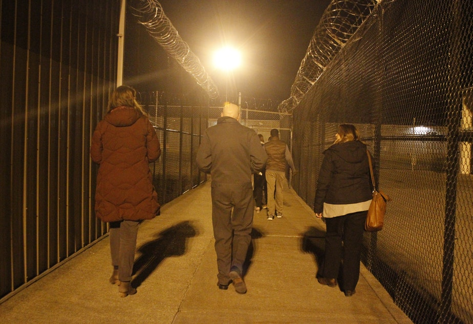 Educators and prison officials leave Monroe Correctional Complex after meeting with the Black Prisoners Caucus on March 1, 2019.