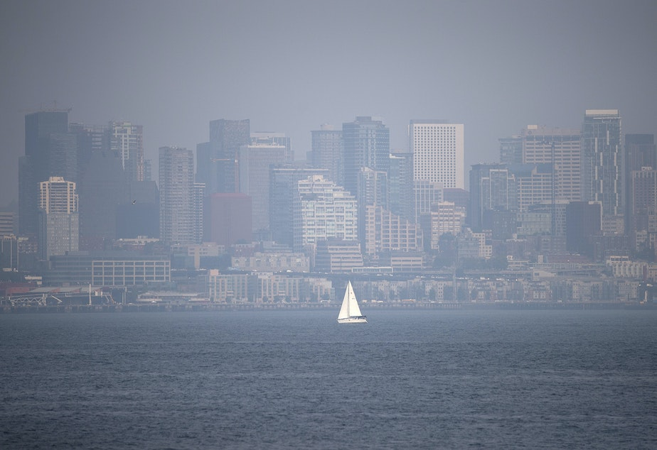 caption: A hazy Seattle skyline is shown on Tuesday, August 14, 2018, from Hamilton Viewpoint Park in West Seattle.