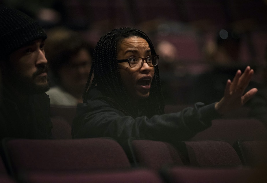 caption: Tierra Johnson reacts to statements made by Seattle Public School officials during a public meeting to address concerns about abusive teachers on Thursday, February 13, 2020 at Garfield High School in Seattle.