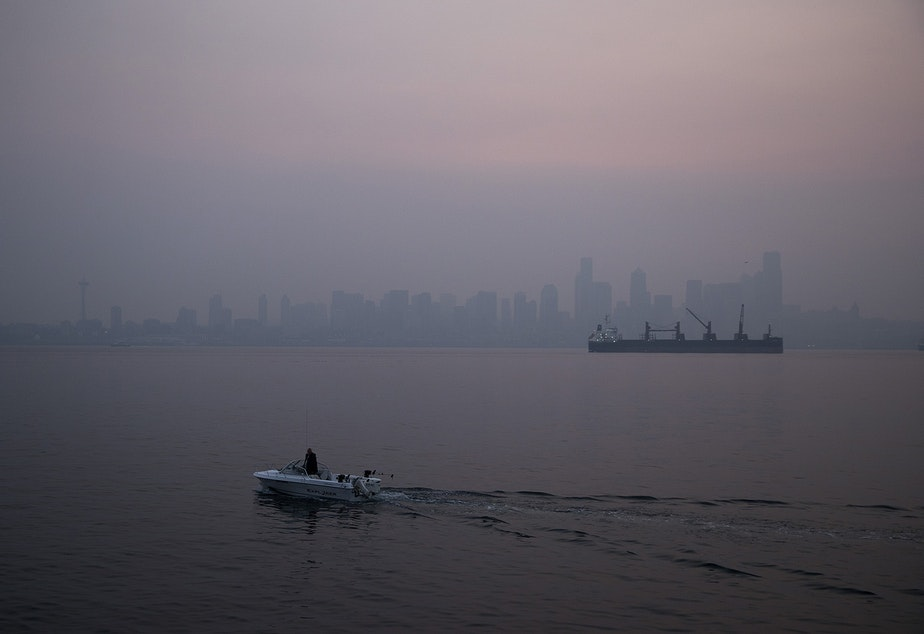 caption: The sun rises over Seattle as a massive plume of smoke from wildfires burning in California and Oregon made it's way into the area, on Friday, September 11, 2020, in Seattle.