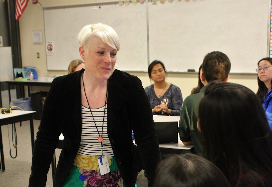 caption: Sammamish High School health teacher Karissa Stay speaks with students about their mental health presentations during the school's recent Health and Wellness Night