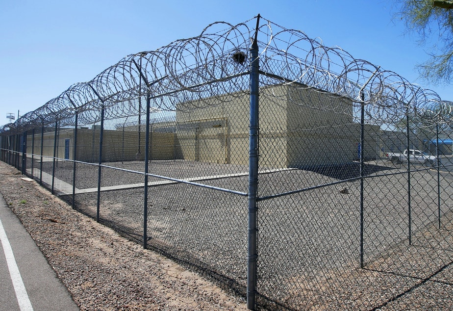 caption: The grounds of the Maricopa County Estrella Jail in Phoenix, Ariz., on March 21, 2020. Some sheriffs want Arizona to follow the lead of other states and release low risk county jail inmates early — to prevent the spread of COVID-19.