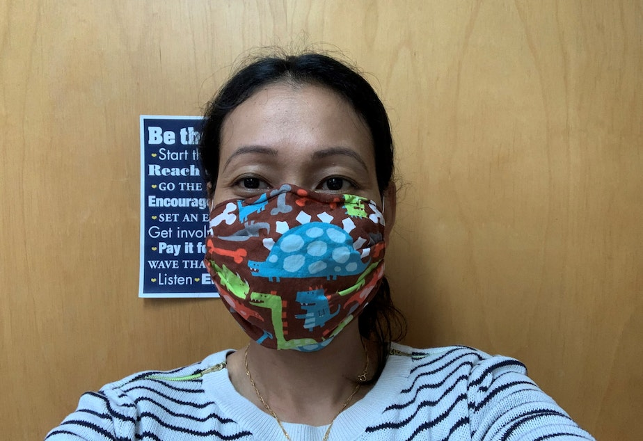 caption: Dental assistant Anita Laigo models a mask she made that's meant to replace an N95 in an emergency situation. Inside is part of an air conditioner filter from Home Depot.