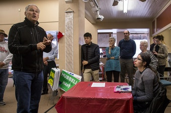 Washington Governor Jay Inslee speaks with Democratic volunteers before a get-out-the-vote event in Grinnell, Iowa in October.
