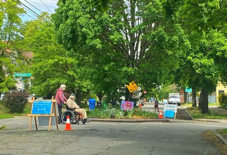 caption: A street is closed off to cars for pedestrian use during the 2020 Covid-19 pandemic in Seattle.
