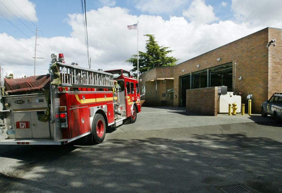 caption: FILE - A fire truck pulls into the Seattle Fire Dept.'s Station 31 following a call Friday, April 16, 2004, in Seattle.
