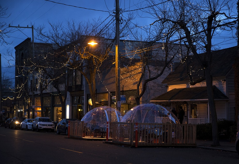 caption: Two clear dome structures for customers to dine in are shown outside of San Fermo on Sunday, November 15, 2020, along Ballard Avenue Northwest in Seattle.