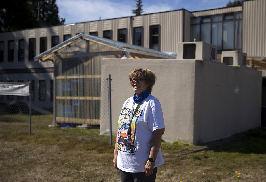 caption: Pastor Jan Bolerjack stands for a portrait on Tuesday, September 22, 2020, at the Tukwila Pantry Food Bank on South 140th Street in Tukwila.