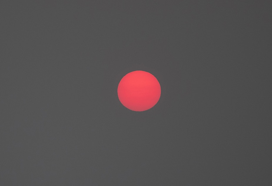caption: The sun rises over Seattle as a massive plume of smoke from wildfires burning in California and Oregon makes it's way into the area on Friday, September 11, 2020.