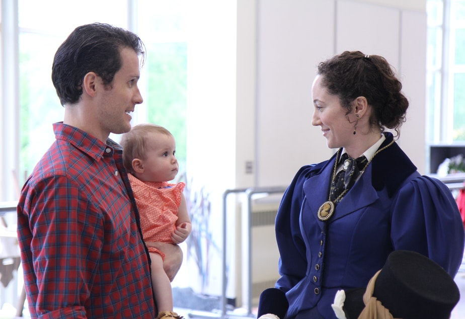 "Sarah Orza, costumed for her role in the ballet ""Giselle,"" with husband Seth and baby Lola"